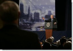 President George W. Bush answers a question from an audience member at the Renaissance Cleveland Hotel in Cleveland, Ohio, following his remarks on the global war on terror, Monday, March 20, 2006, to members of the City Club of Cleveland.  White House photo by Paul Morse
