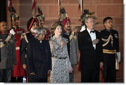 President and Mrs. Bush stand with India's President A.P.J. Abdul Kalam during the playing of their respective national anthems Thursday, March 2, 2006, at the State Dinner in New Delhi.  White House photo by Eric Draper