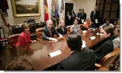 President George W. Bush and Mrs. Laura Bush meet Tuesday, March 21, 2006 in the Roosevelt Room of the White House, with members of the Iraq and Afghanistan Non-Govermental Organizations. White House photo by Eric Draper