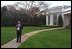 White House Chief of Staff Andy Card watches President George W. Bush depart from the South Lawn April 12, 2001