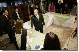 President George W. Bush greets participants, Saturday, March 4, 2006 at the Roundtable with Pakistani Society Representatives at the U.S. Embassy in Islamabad, Pakistan.  White House photo by Eric Draper