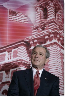 President George W. Bush stands before a backdrop of Ellis Island, Monday, March 27, 2006, at the Naturalization Ceremony for new U.S. citizens at the Daughters of the American Revolution Administration Building in Washington. President Bush welcomed the new U.S. citizens, telling them that each generation of immigrants brings a renewal to our national character and adds vitality to our culture.  White House photo by Eric Draper