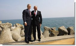 President George W. Bush and President Traian Basescu of Romania, pose for photographs Wednesday, April 2, 2008, on a seawall at the presidential retreat in Neptun, Romania. President Bush spent the day with his Romanian counterpart before the opening of the 2008 NATO Summit. White House photo by Eric Draper