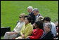 Mrs. Laura Bush joined by Mrs. Kim Yoon-ok, wife of the South Korean President Lee Myung-bak, U.S. Secretary of State Condoleezza Rice, and U.S. Defense Secretary Robert Gates listen during a joint press availability with President George W. Bush and South Korean President Lee Myung-bak Saturday, April 19, 2008, at the Presidential retreat at Camp David, Md. White House photo by Joyce N. Boghosian
