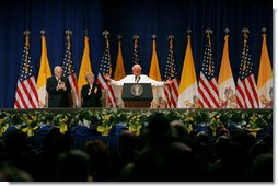 Pope Benedict XVI, joined on stage by Vice President Dick Cheney and Mrs. Lynne Cheney, gestures to the faithful Sunday, April 20, 2008 at a farewell ceremony for the Pope at John F. Kennedy International Airport in New York.  White House photo by Shealah Craighead