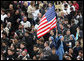 An American flag flies high above the throng of mourners inside St. Peter's square Friday, April 8, 2005, as thousands attend funeral mass for Pope John Paul II, who died April 2 at the age of 84. White House photo by Eric Draper
