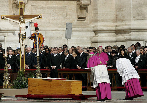 Archbishop Piero Marini, left, chief liturgist to Pope John Paul II, bows to his casket during the Pope's funeral Friday, April 8, 2005, in St. Peter's Square.White House photo by Eric Draper