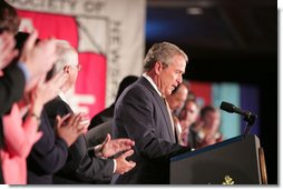 President George W. Bush receives a welcoming ovation as he arrives at the J.W. Marriott Hotel in Washington DC Thursday, April 14, 2005, to address the American Society of Newspaper Editors annual convention.  White House photo by Paul Morse
