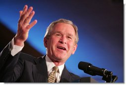 President George W. Bush acknowledges a Texas newspaperman during opening remarks in his address Thursday, April 14, 2005, to the American Society of Newspaper Editors, meeting in Washington DC.  White House photo by Paul Morse