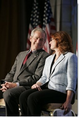 President George W. Bush shares the spotlight with Marianne Sensale-Guerin, 2005 SBA National Small Business Person of the Year, during his address to the National Small Business Week Conference in Washington, D.C., Wednesday, April 27, 2005.  White House photo by Paul Morse