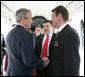 President George W. Bush and Ukraine President Viktor Yushchenko shake hands upon Mr. Yushchenko's departure Monday, April 4, 2005, following his visit to the White House.White House photo by Eric Draper