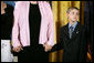 Eleven-year-old David Smith looks solemnly towards the audience as he and his step-sister Jessica, left, hold their mom's hands during ceremonies Monday, April 4, 2005, at the White House. David's father, Sgt. 1st Class Paul Smith, was honored posthumously by President Bush with the Medal of Honor, the first presented for service in support of Operation Iraqi Freedom.White House photo by Eric Draper