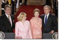President George W. Bush and Ukraine President Viktor Yushchenko are joined at the podiums by first ladies Laura Bush and Kateryna Yushchenko Monday, April 4, 2005, in the East Room of the White House. White House photo by Paul Morse