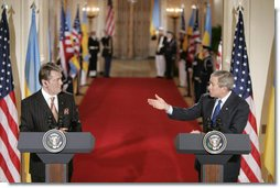 President George W. Bush gestures to Ukraine President Viktor Yushchenko Monday, April 4, 2005, during a press availability at the White House. White House photo by Paul Morse