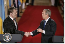 President Bush and President Yushchenko shake hands after a press availability Monday, April 4, 2005. The Ukraine president and his wife visited the White House for the day. White House photo by Paul Morse