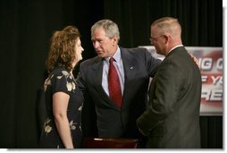 President George W. Bush greets Galveston County Employees Bea Bentley and her husband Christopher at the end of a roundtable discussion on Strengthening Social Security at the University of Texas Medical Branch in Galveston, Texas, Tuesday, April 26, 2005.  White House photo by Eric Draper