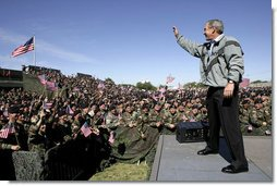 """President George W. Bush waves to the troops at Fort Hood, Texas, as he arrived Tuesday, April 12, 2005, to thank them in person for their service in Iraq. """"Americans are grateful for your sacrifice and your service,"""" the President told a large portion of the 44,188 soldiers and airmen stationed at the base. """".And so is your Commander-in-Chief.""""  White House photo by Eric Draper"""