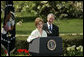 President George W. Bush looks on as he's introduced by First Lady Laura Bush Wednesday, April 20, 2005, to honor the 2005 National Teacher of the Year during ceremonies in the Rose Garden. Jason Kamras, a math teacher of eight years at John Philip Sousa Middle School in Washington, D.C., received the honors. White House photo by Krisanne Johnson