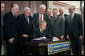 President George W. Bush signs into law S.256, the Bankruptcy Abuse Prevention and Consumer Protection Act of 2005, Wednesday, April 20, 2005, at the Eisenhower Executive Office Building. Watching on, from left are: Senator Tom Carper, D-Del.; Congressman Steve Chabot, R-Ohio; House Speaker Dennis Hastert, R-Ill.; Congressman Jim Sensenbrenner, Jr., R-Wis., Chairman of the Judiciary Committee; Senator Chuck Grassley, R-Iowa, chairman of the Finance Committee; Senator Mitch McConnell, R-Ky.; Majority Whip Senator Orrin Hatch, R-Utah, and Congressman Rick Boucher, D-Va. White House photo by Paul Morse