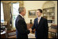 """President George W. Bush welcomes Jason Kamras, the 2005 National Teacher of the Year, to the Oval Office during ceremonies Wednesday, April 20, 2005, at the White House. Mr. Kamras, a 1996 Princeton graduate, teaches seventh and eighth grade math at John Philip Sousa Middle School in Washington, D.C. """"Teaching is a commitment to equity and opportunity for all children,"""" says Mr. Kamras, who took time away from teaching in 1999-2000 to earn his Master's degree at Harvard. """"It is a promise of a better future for those who have been left behind."""" White House photo by Eric Draper"""
