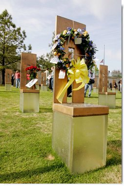 Flowers and personal items are left on several of the 168 memorial chairs at the Oklahoma City National Memorial on the 10th anniversary of the bombing of the Alfred P. Murrah Federal Building in Oklahoma City, Okla. The chairs stand in remembrance of the 168 people who died from the April 19, 1995 terrorist attack.  White House photo by David Bohrer