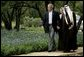 """President George W. Bush welcomes Saudi Crown Prince Abdullah to his ranch Monday, April 25, 2005, in Crawford, Texas. The President told the media on hand he looked forward to """"talking with him about a variety of subjects."""" White House photo by David Bohrer"""