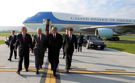 Arriving in Harrisburg, Pa., President George W. Bush walks with Pennsylvania Attorney General Mike Fisher, far left, Rep. George Gekas, center, and Governor Mark Schweiker Friday, Nov. 1. White House photo by Paul Morse.