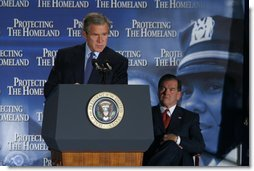 """President George W. Bush delivers remarks about the need to have the Senate pass the Homeland Security Bill during the Lame Duck session of Congress after his tour of the District of Columbia's Metropolitan Police Department Synchronized Operations Center, Tuesday, Nov 12. """"The Congress is in session today, and the House and the Senate have pressing responsibilities to work with us for our security. And I'm confident they'll meet those responsibilities. And the single most important business before Congress is the creation of a department of homeland security,"""" said President Bush.   White House photo by Paul Morse"""