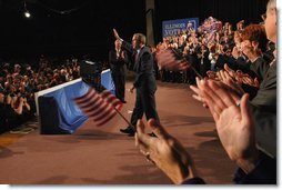 President George W. Bush acknowledges the crowd during his introduction at the Illinois Welcome at the Illinois Police Armory in Springfield, Illinois, Sunday, Nov. 3, 2002  White House photo by Eric Draper