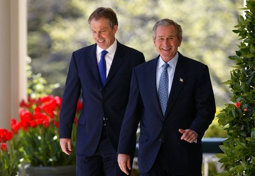President George W. Bush and Prime Minister Tony Blair walk along the colonnade before a press conference in the Rose Garden of the White House on April 16, 2004. White House photo by Paul Morse.