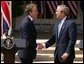 President George W. Bush and Prime Minister Tony Blair shake hands after a press conference in the Rose Garden of the White House on April 16, 2004. White House photo by Paul Morse.