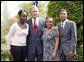 President George W. Bush congratulates the Groundwork Providence Environmental Team of Providence, R.I., on receiving the President's Environmental Youth Award in the East Garden April 22, 2004. Members of the team include, from left to right, Olabisi Davies, 17, Taja Gonsalves, 15, and Miguel Blanco, 16.