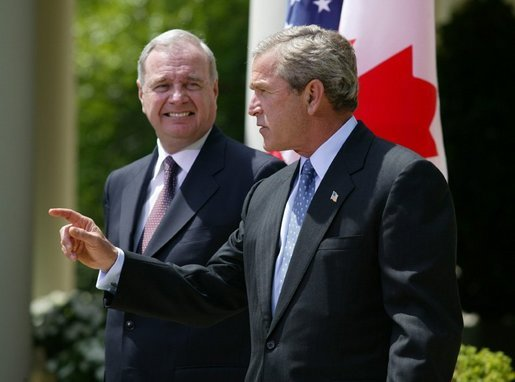 President George W. Bush and Canadian Prime Minister Paul Martin respond to questions from the press corps in the Rose Garden after a meeting at the White House on April 30, 2004. White House photo by Paul Morse