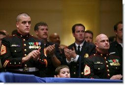 Local military and emergency first responders listen to President George W. Bush talk about the USA Patriot Act in Hershey, Pa., Monday, April 19, 2004.  White House photo by Paul Morse