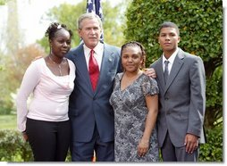President George W. Bush congratulates the Groundwork Providence Environmental Team of Providence, R.I., on receiving the President's Environmental Youth Award in the East Garden April 22, 2004. Members of the team include, from left to right, Olabisi Davies, 17, Taja Gonsalves, 15, and Miguel Blanco, 16.  White House photo by Susan Sterner