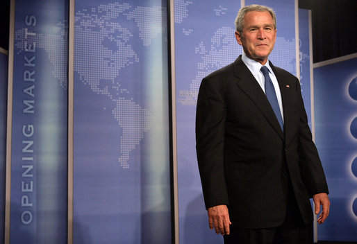 """President George W. Bush stands on stage at the Radisson Miami Hotel Friday, Oct. 12, 2007, in Miami, where he delivered remarks on trade policy. Speaking on free trade in the Americas, the President said, """"It's in the interests of the United States that prosperity spread through Latin America and South America."""" White House photo by Eric Draper"""