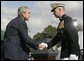 President George W. Bush and outgoing Joint Chiefs of Staff Chairman U.S. Marine General Peter Pace shake hands during the Armed Forces farewell tribute in honor of General Pace and the Armed Forces hail in honor of the new Joint Chiefs of Staff Chairman Navy Admiral Michael Mullen, Monday, October 1, 2007 at Fort Myer, Virginia. General Pace is retiring after serving two years as chairman and 40 years in the U.S. Marines. White House photo by Eric Draper