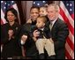 President George W. Bush is seen Thursday, Dec. 1. 2005 in the Eisenhower Executuive Office Building in Washington, as he poses for photos with U.S. Rep. Jesse Jackson Jr. and his children, Jesse Jackson III and Jessica, following the signing of H.R. 4145, to Direct the Joint Committee on the Library to Obtain a Statue of Rosa Parks, which will be placed in the US Capitol's National Statuary Hall. U.S. Secretary of State Condoleezza Rice is seen at left. White House photo by Paul Morse
