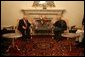 Vice President Dick Cheney and a US delegation meet with Afghan President Hamid Karzai after attending the opening session of the Afghan Parliament, the first elected parliament in more than three decades, in Kabul, Afghanistan Monday, Dec. 19, 2005. White House photo by David Bohrer