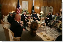 """Vice President Dick Cheney discusses earthquake relief efforts with Pakistani President Pervez Musharraf, Tuesday Dec. 20, 2005. President Musharraf thanked the Vice President for the US relief assistance and said, """"I don't think we could have managed the relief operation without your support.""""  White House photo by David Bohrer"""