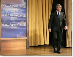 President George W. Bush walks onto the stage during his introduction before delivering remarks on the War on Terror in front of members of the World Affairs Council of Philadelphia, Monday, Dec. 12, 2005.  White House photo by Eric Draper