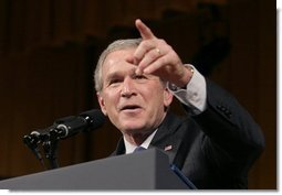 President George W. Bush points to a member of the audience during a question and answer segment, after delivering remarks on the War on Terror before members of the World Affairs Council of Philadelphia, Monday, Dec. 12, 2005.  White House photo by Eric Draper