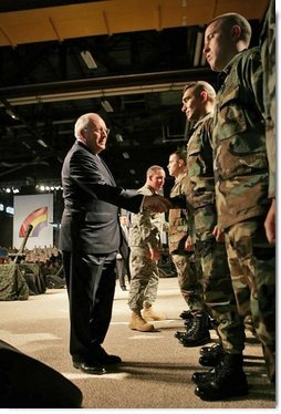 Vice President Dick Cheney congratulates troops during a Re-enlistment Ceremony at Fort Drum, N.Y., Tuesday, Dec. 6, 2005. During his visit, the Vice President also participated in a Purple Heart Award Ceremony and met one-on-one with troops.  White House photo by David Bohrer