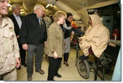 """Vice President Cheney and Mrs. Lynne Cheney visit the 212th M.A.S.H.(Mobile Army Surgical Hospital) Unit run by the U.S. military in a mountainous area near the earthquake's epicenter, 65 miles northwest of Islamabad, Pakistan, Tuesday Dec. 20, 2005. During the visit the Vice President said he was """"impressed with what we've been able to do with our M.A.S.H. units. U.S. forces were able to move quickly into the area. We were here within 48 hours and we've been here ever since.""""  White House photo by David Bohrer"""
