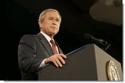 """President Bush acknowledges applause during his remarks on the War on Terror Wednesday, Dec. 14, 2005, at the Woodrow Wilson International Center for Scholars in Washington D.C. Speaking of this week's elections in Iraq, President Bush told the audience, """"We are living through a watershed moment in the story of freedom.""""  White House photo by Kimberlee Hewitt"""