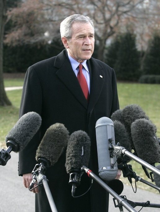 "President George W. Bush speaks to the media Thursday, Dec. 22, 2005, on the South Lawn of the White House before leaving for Camp David. The President spoke about the Patriot Act extension saying, ""We're still under threat, there's still an enemy that wants to harm us and they understand the Patriot Act is an important tool for those of us here in the Executive Branch to use to protect our fellow citizens."" White House photo by Kimberlee Hewitt"