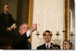 President George W. Bush participates in the Menorah lighting at the White House with Rabbi Joshua Skoff and members of the Skoff family, Tuesday, Dec. 6, 2005, prior to the annual White House Hanukkah reception. White House photo by Kimberlee Hewitt