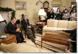 President George W. Bush listens as Dr. Lee Jong-wook, the Director-General of the World Health Organization, answers reporters questions, Tuesday, Dec. 6, 2005 in the Oval Office.  White House photo by Eric Draper