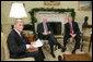 President George W. Bush meets with U.S. Senator John McCain, R-Ariz., and U.S. Senator John Warner, R-Va., Thursday, Dec. 15, 2005 in the Oval Office, to discuss the U.S. position on the interrogation of prisoners. White House photo by Paul Morse
