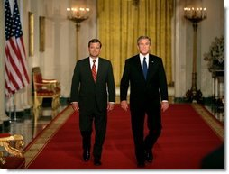 President George W. Bush walks with his Supreme Court Justice Nominee John Roberts before delivering the announcement on the State Floor of the White House, Tuesday evening, July 19, 2005.  White House photo by Eric Draper